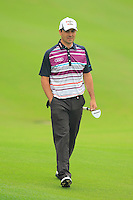 Felipe Aguilar (CHI) walks to the 16th green during Friday's Round 2 of the 2014 BMW Masters held at Lake Malaren, Shanghai, China 31st October 2014.<br /> Picture: Eoin Clarke www.golffile.ie