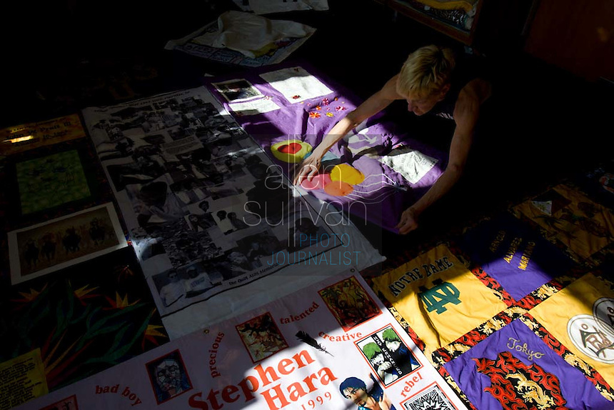 Gert McMullin designs a panel of the AIDS Memorial Quilt at its headquarters. Weighing 54 tons, the quilt now has over 5700 12' X 12' panels encompassing about 80,000 names of people whose lives the disease has claimed, said McMullin, the quilt's production manager. She said she has lost about 300 friends to AIDS and was one of the two original volunteers that started the quilt in San Francisco. She moved along with it to its present home in Atlanta.