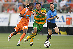 14 May 2010: Carolina's Gregory Richardson (GUY) (20) and Tampa Bay's Takuya Yamada (JPN) (right) chase the ball. The FC Tampa Bay Rowdies defeated the Carolina RailHawks 2-1 at WakeMed Stadium in Cary, North Carolina in a regular season U.S. Soccer Division-2 soccer game.