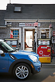 MASSACHUSETTS, Martha's Vineyard, Blue Mini Cooper parked infront of a gas station