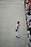 Participant is seen before the bull run of the San Fermin Festival, on July 9, 2013, in Pamplona, northern Spain. (c) Pedro ARMESTRE