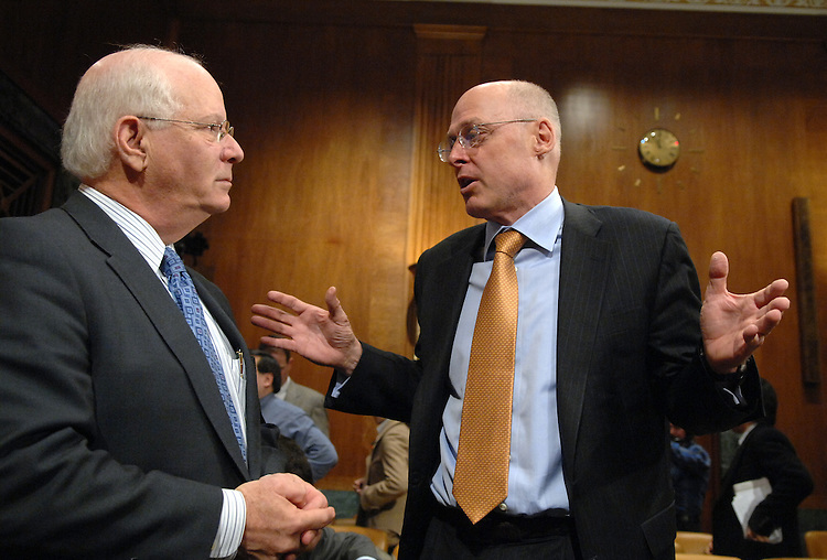 Secretary of the Treasury Henry Paulson, right, talks with Sen Ben Cardin, D-Md., after a Senate Budget Committee hearing on the President's FY2008 budget.