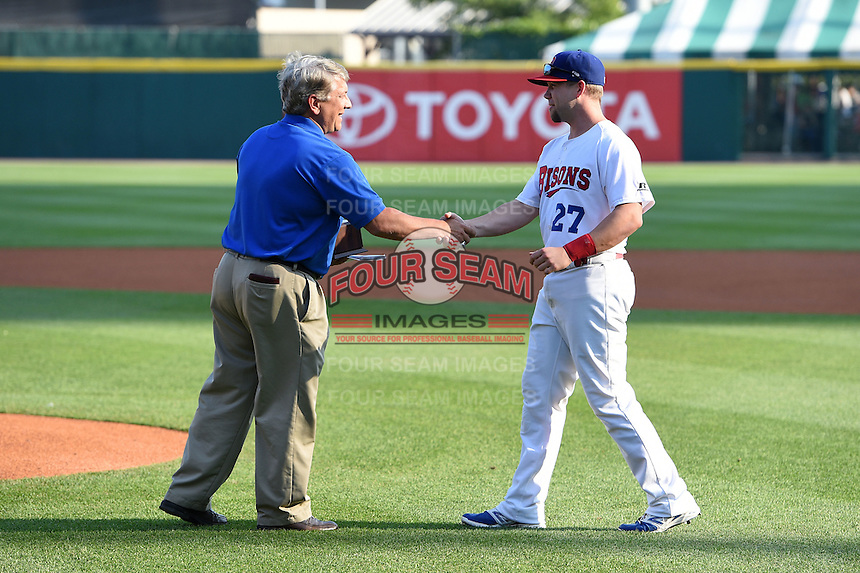 "Buffalo Bisons second baseman Ryan Schimpf (27) is awarded the Frank J. ""Fremo"" Vallone Community Service Award during a ceremony before a game against the Pawtucket Red Sox on August 26, 2014 at Coca-Cola Field in Buffalo, New  York.  Pawtucket defeated Buffalo 9-3.  (Mike Janes/Four Seam Images)"