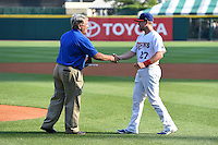 """Buffalo Bisons second baseman Ryan Schimpf (27) is awarded the Frank J. """"Fremo"""" Vallone Community Service Award during a ceremony before a game against the Pawtucket Red Sox on August 26, 2014 at Coca-Cola Field in Buffalo, New  York.  Pawtucket defeated Buffalo 9-3.  (Mike Janes/Four Seam Images)"""