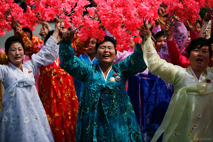 Women wearing traditional clothes react as they march past the stand with North Korean leader Kim Jong Un during a military parade marking the 105th birth anniversary of country's founding father, Kim Il Sung in Pyongyang, April 15, 2017.    REUTERS/Damir Sagolj
