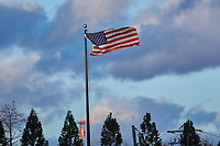The American flag waves in the breeze beyond the center field fence  at David F. Couch Ballpark prior to the ACC baseball game between the Louisville Cardinals and the Wake Forest Demon Deacons on March 6, 2020 in  Winston-Salem, North Carolina. The Cardinals defeated the Demon Deacons 4-1. (Brian Westerholt/Four Seam Images)