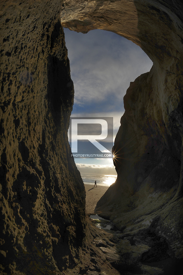 """A """"cave"""" -- really a small indent into the cliff on the North end of Hug Point. You must be there at low tide to see this view of the area."""