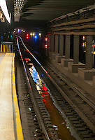 Signal lights are seen reflected in water in the subway track bed at the 125th Street Station in Harlem on the IND line in New York on Monday, January 16m 2012. Richard B. Levine)