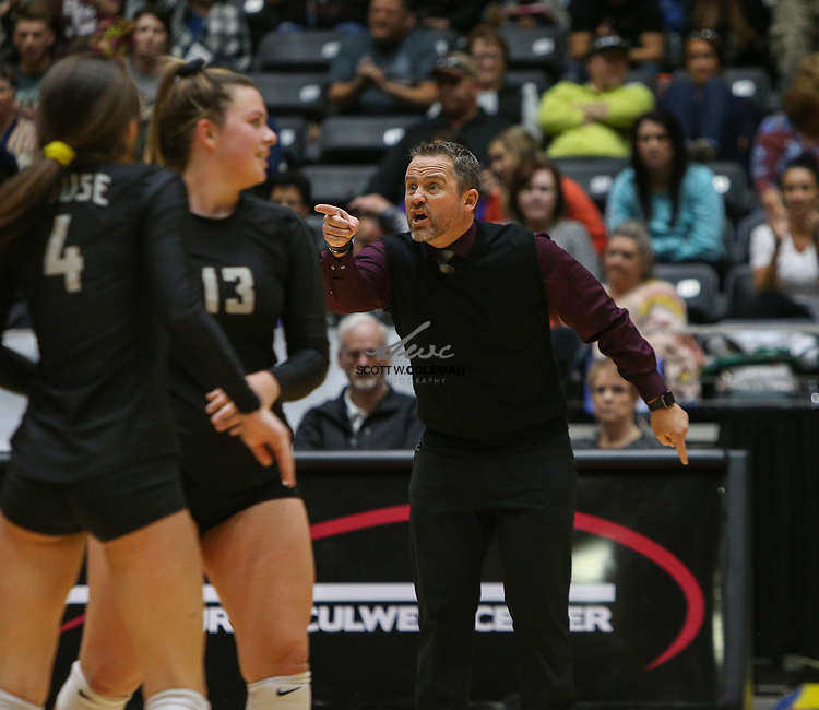Rouse Raiders head coach Jacob Thompson in the bench area during the Class 5A high school volleyball state final between Rouse High School and Prosper High School at Curtis Culwell Center in Garland, Texas, on November 18, 2017. Prosper won the match in five sets, (25-18, 21-25, 18-25, 25, 23, 16-14) to win the 5A state championship.