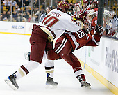 Jimmy Hayes (BC - 10), Chris Huxley (Harvard - 28) - The Boston College Eagles defeated the Harvard University Crimson 6-0 on Monday, February 1, 2010, in the first round of the 2010 Beanpot at the TD Garden in Boston, Massachusetts.