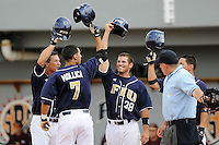 27 April 2008: Florida International's Ty Main (5, far left), Raimy Fuentes (38), and Corey Lozano (1, far right) wait at home plate to celebrate the grand slam home run by Ryan Mollica (7) in the bottom of the fifth inning of the FIU 17-10 victory over Louisiana at Monroe at University Park Stadium in Miami, Florida.