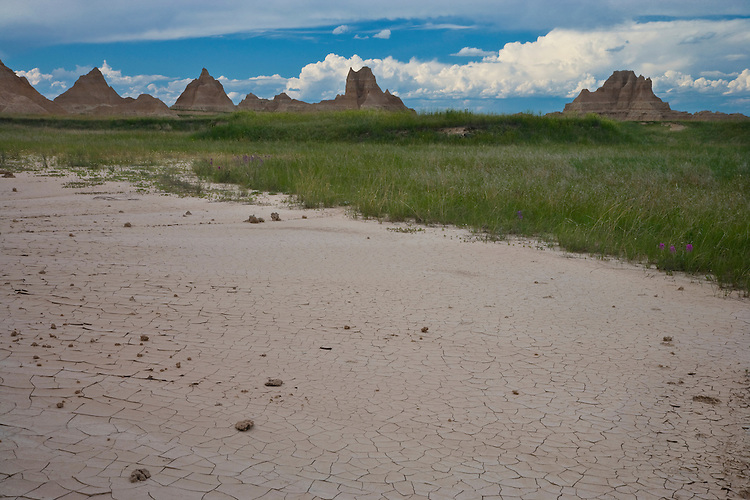 Rain clouds over the badland formations near the Door/Window Trail; Badlands National Park, SD