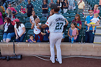 Salt River Rafters outfielder Jerar Encarnacion (27), of the Miami Marlins organization, signs autographs after winning the Arizona Fall League Championship Game against the Surprise Saguaros on October 26, 2019 at Salt River Fields at Talking Stick in Scottsdale, Arizona. The Rafters defeated the Saguaros 5-1. (Zachary Lucy/Four Seam Images)