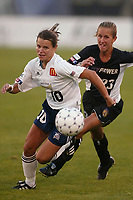 Sherrill Kester of the SanDiego Spirit being chased by Emily Stauffer of the New York Power. The Spirit defeated the Power 1-0 on July 20th at Mitchel Athletic Complex, Uniondale, NY.