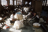 February 1975, Pokhara area, Nepal. Daily life. Street scene, cotton workers.