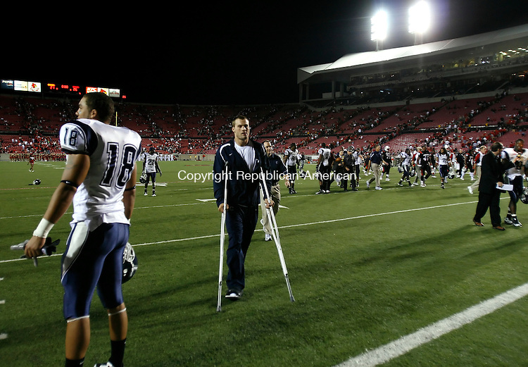 LOUISVILLE, KY, 09/26/08- 092608BZ15- UConn's   Tyler Lorenzen (4) walks off the field on crutches after UConn beat Louisville 26-21 Friday night.<br /> Jamison C. Bazinet Republican-America