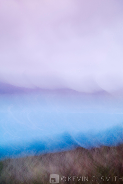 Kalsin Bay with the Marin Range in the background, blurred motion abstract, stormy fall day, Kodiak Alaska, USA.