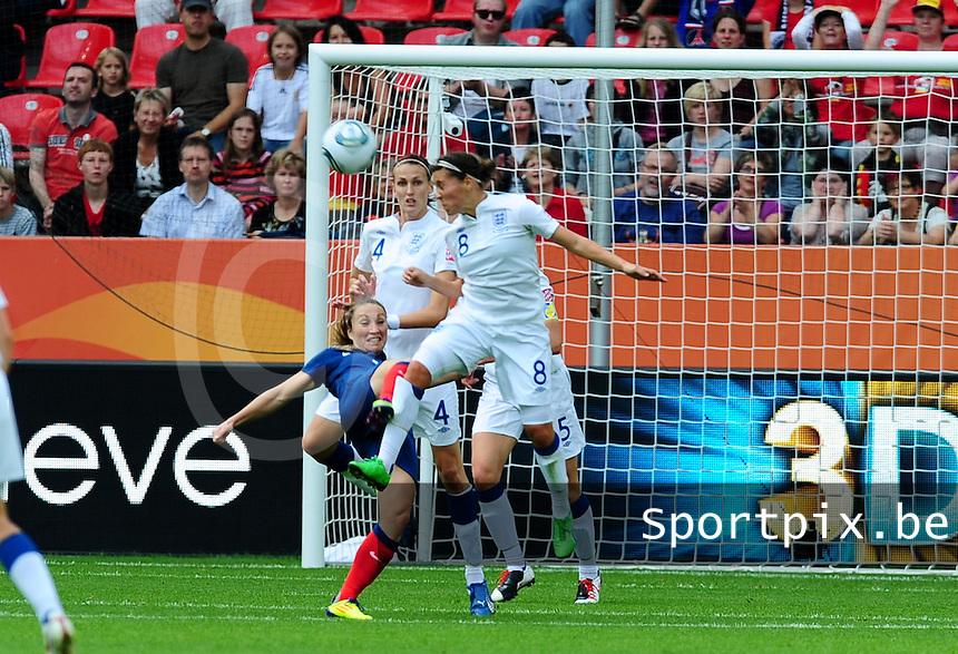 Fifa Women's World Cup Germany 2011 : England - France - at Leverkusen : Fara Williams kopt de bal weg voor Gaetane Thiney kan scoren met een omhaal.foto DAVID CATRY / Vrouwenteam.be