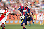 Rayo Vallecano´s Kakuta (L) and Barcelona´s Mathieu during La Liga match between Rayo Vallecano and Barcelona at Vallecas stadium in Madrid, Spain. October 04, 2014. (ALTERPHOTOS/Victor Blanco)
