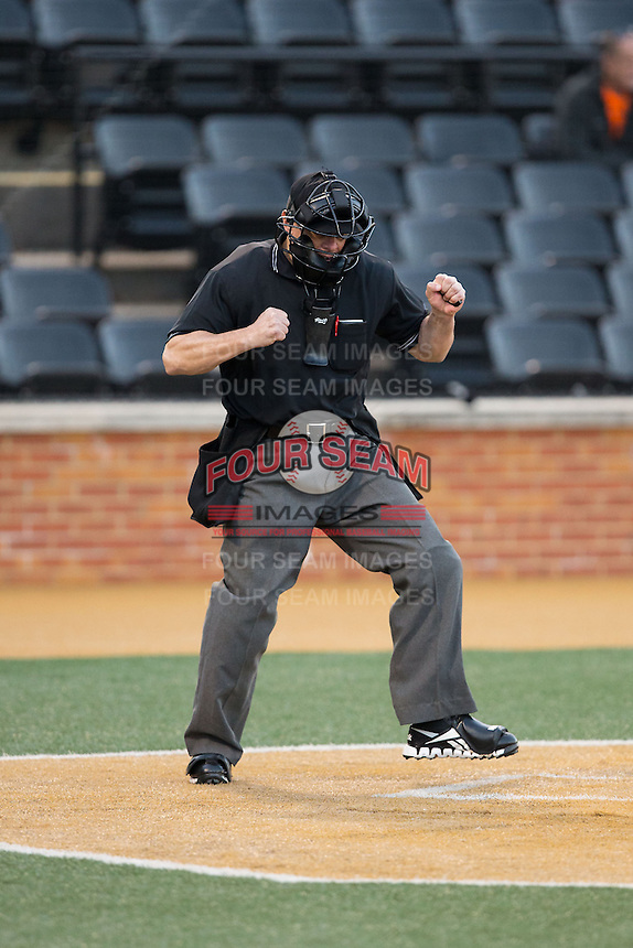 Home plate umpire Gary Swanson calls a batter out on strikes during the NCAA baseball game between the UConn Huskies and the Wake Forest Demon Deacons at Wake Forest Baseball Park on March 17, 2015 in Winston-Salem, North Carolina.  The Demon Deacons defeated the Huskies 6-2.  (Brian Westerholt/Four Seam Images)
