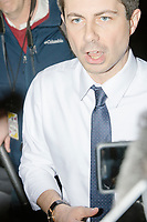 Democratic presidential candidate Pete Buttigieg speaks to the media during an avail at a campaign event at the Currier Museum of Art in Manchester, New Hampshire, USA, on Fri., Apr. 5, 2019. The venue was filled to capacity about an hour before the candidate's arrival, so Buttigieg delivered an impromptu speech to those denied entry outside the museum before the official event. Buttigieg is the mayor of South Bend, Indiana, and was widely considered a long-shot candidate until his appearance in a CNN town hall in March 2019 which catapulted his campaign to prominence and substantial donations.
