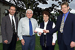 Jimmy Macfarlane and Padraig Moynihan from donacarney Parent's Council presenting Joseph Heeney, principal boys school and Brigid Weir, principal girls school with a cheque for £1,000 to go towards computer equipment..Picture Paul Mohan Newsfile