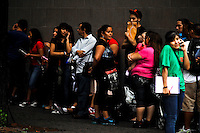 Hundreds of people line up in Queens to apply for deportation reprieve aplication..Young Hispanic activists who promote the DREAM Act, represent an important base of support for Obama, as immigration becomes a decisive issue in the upcoming election. 2012 in New York, United States. 15/08/2012. Photo by Joana Toro/VIEWpress.