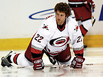 6 February 2007: Carolina Hurricanes defenseman Mike Commodore stretches out during a pre-game warm-up prior to facing the Montreal Canadiens at the Bell Centre in Montreal, Canada. ....Mandatory Photo Credit: Ed Wolfstein Photo *** Editorial Sales through Icon Sports Media *** www.iconsportsmedia.com
