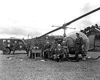 Personnel and equipment needed to save a man'life are assembled at HQs of the 8225th Mobile Army Surgical Hospital, Korea.  October 14, 1951.  Cpl. Charles Abrahamson.  (Army)<br /> NARA FILE #  111-SC-382662<br /> WAR & CONFLICT BOOK #:  1457