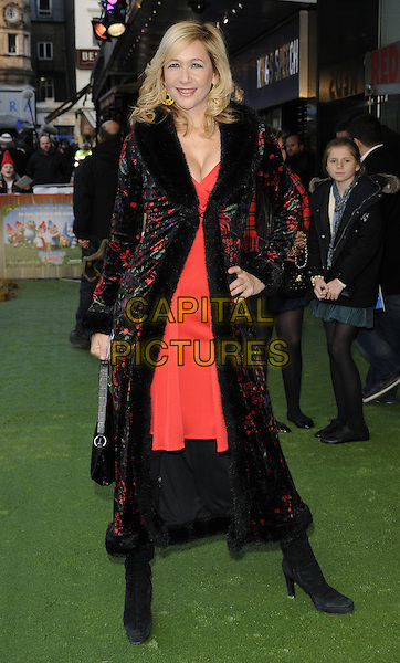 TANIA BRYER .Attending the 'Gnomeo And Juliet' UK film premiere, Odeon cinema, Leicester Square, London, England, UK,.30th January 2011..& arrivals full length black velvet collar coat hand on hip red dress floral print embroidered  long fur trim trimmed boots bag .CAP/CAN.©Can Nguyen/Capital Pictures.