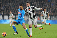 Calcio, semifinale di andata di Tim Cup: Juventus vs Napoli. Torino, Juventus Stadium, 28 febbraio 2017.<br /> Napoli's Raul Albiol, left, is challenged by Juventus&rsquo; Gonzalo Higuain during the Italian Cup semifinal first leg football match between Juventus and Napoli at Turin's Juventus stadium, 28 February 2017.<br /> UPDATE IMAGES PRESS/Manuela Viganti<br /> <br /> GONZALO HIGUAIN E RAUL ALBIOL