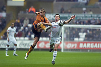 Pictured: Marcos Painter of Swansea City in action <br />