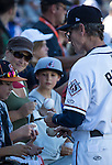 Aces manager Brett Buttler signs a ball forfans before the Triple-A All-Star game played on Wednesday night, July 17, 2013 at Aces Ballpark in Reno, Nevada.