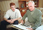JIMMY McDONNELL AND OLLIE LOOKING BACK AT PICTURES FROM LOUTH TEAM IN 57.PIC: NEWSFILE