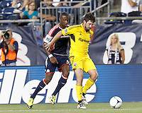 Columbus Crew defender Danny O'Rourke (5) controls and shields ball from New England Revolution forward Dimitry Imbongo (92). In a Major League Soccer (MLS) match, the New England Revolution defeated Columbus Crew, 2-0, at Gillette Stadium on September 5, 2012.
