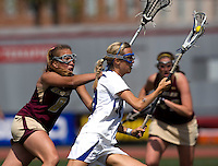 Lindsay Gilbride (18) of Duke is defended by  Hannah Alley (8) of Boston College during the first round of the ACC Women's Lacrosse Championship in College Park, MD.  Duke defeated Boston College, 17-6.