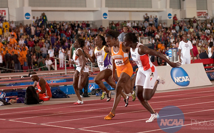 10 MAR 2007: Kerron Stewart (4) of Auburn University and Courtney Champion of the University of Tennessee run the 60 meter dash during the Division I Indoor Track and Field Championships held at the Randal Tyson Track Complex on the University of Arkansas campus in Fayetteville, Ark. Stewart won with a 7.15  time. Phillip Walrod/NCAA Photos.