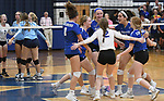 Marquette players celebrate after they scored. Jerseyville played at Alton Marquette in a girls volleyball game on Wednesday September 11, 2018.<br /> Tim Vizer/Special to STLhighschoolsports.com