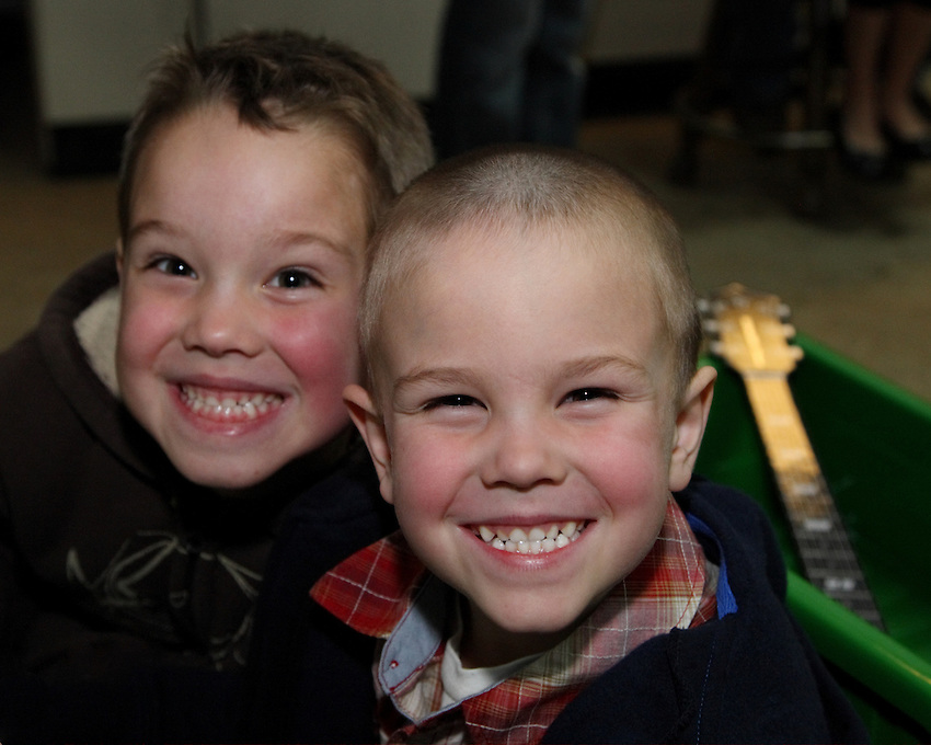 "Aidan & Eli with ""cheesy"" smiles :)"