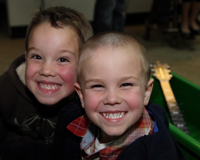 "Aidan & Eli with ""cheesy"" smiles :)"