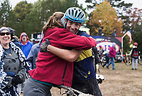 NWA Democrat-Gazette/CHARLIE KAIJO Bryan Pendergraft of Conway hugs friends and family after crossing the finish line during a bike race, Sunday, November 4, 2018 at Lake Leatherwood MTB Park in Eureka Springs.<br />