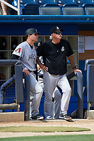 Jackson Generals manager J.R. House (22) talks with pitching coach Doug Drabek (15) in the dugout during a game against the Biloxi Shuckers on April 23, 2017 at MGM Park in Biloxi, Mississippi.  Biloxi defeated Jackson 3-2.  (Mike Janes/Four Seam Images)