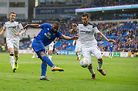 Junior Hoilett of Cardiff City shoots at goal under pressure from Bradley Johnson of Derby County during the Sky Bet Championship match between Cardiff City and Derby County at Cardiff City Stadium, Cardiff, Wales on 30 September 2017. Photo by Mark  Hawkins / PRiME Media Images.
