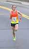 Parker Stinson, 23, of Eugene, OR (Bib No. 2) closes in on victory during Northport's annual Cow Harbor 10-kilometer run on Saturday, September 19, 2015. He went on to win the race with a time of 29:11.82.<br /> <br /> James Escher
