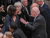 former first lady Michelle Obama and United States Senator Patrick Leahy (Democrat of Vermont) converse prior to the National funeral service in honor of the late former US President George H.W. Bush at the Washington National Cathedral in Washington, DC on Wednesday, December 5, 2018.<br /> Credit: Ron Sachs / CNP<br /> (RESTRICTION: NO New York or New Jersey Newspapers or newspapers within a 75 mile radius of New York City)