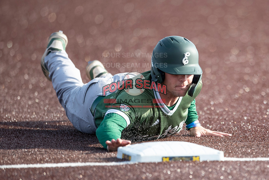 Eastern Michigan Eagles third baseman Devin Hager (23) dives back to first base during the NCAA baseball game against the Michigan Wolverines on May 8, 2019 at Ray Fisher Stadium in Ann Arbor, Michigan. Michigan defeated Eastern Michigan 10-1. (Andrew Woolley/Four Seam Images)