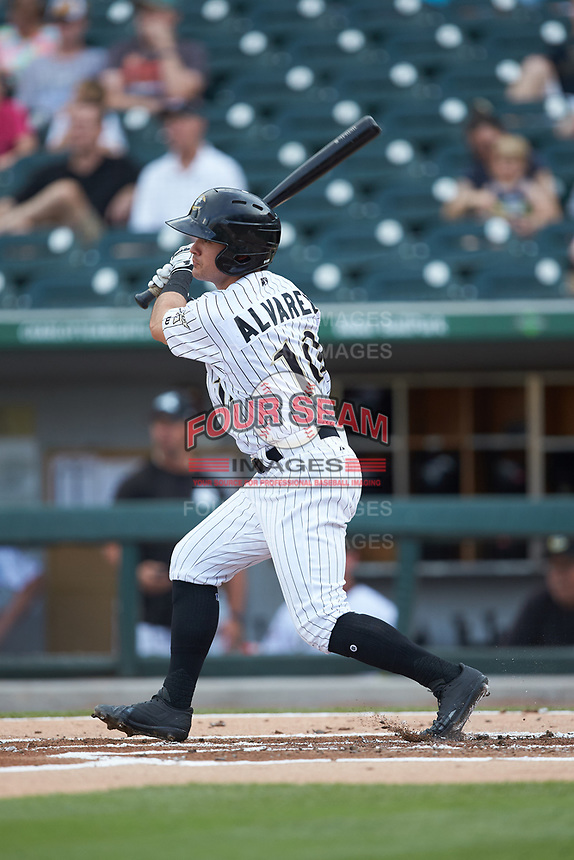 Eddy Alvarez (10) of the Charlotte Knights follows through on his swing against the Indianapolis Indians at BB&T BallPark on May 26, 2018 in Charlotte, North Carolina. The Indians defeated the Knights 6-2.  (Brian Westerholt/Four Seam Images)
