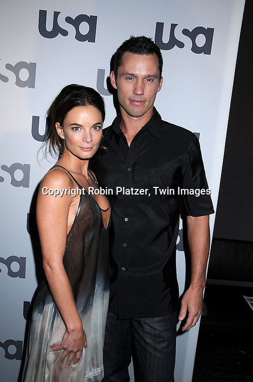 "Gabrielle Anwar and Jeffrey Donovan of ""Burn Notice"".posing for photographers at The USA Network Upfront.on March 26, 2008 at The Modern. ..Robin Platzer, Twin Images"