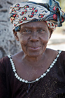 Kizimkazi Dimbani, Zanzibar, Tanzania.  Old Woman.  Her face is speckled with sand, from beating coconut husks on the beach, to make coir for rope.