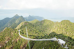 Langkawi cable car is the steepest cable car ride on earth and takes visitors up 708m above sea level to the curved pedestrian sky bridge is built atop Langkawi's second highest peak of Mt. Machinchang. <br /> Langkawi, officially known as Langkawi the Jewel of Kedah (Malay: Langkawi Permata Kedah) is an archipelago of 104 islands in the Andaman Sea, some 30 km off the mainland coast of northwestern Malaysia. The islands are a part of the state of Kedah, which is adjacent to the Thai border.